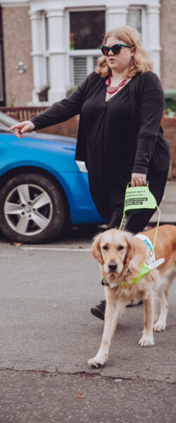 Amy and Guide Dog Ava crossing the road